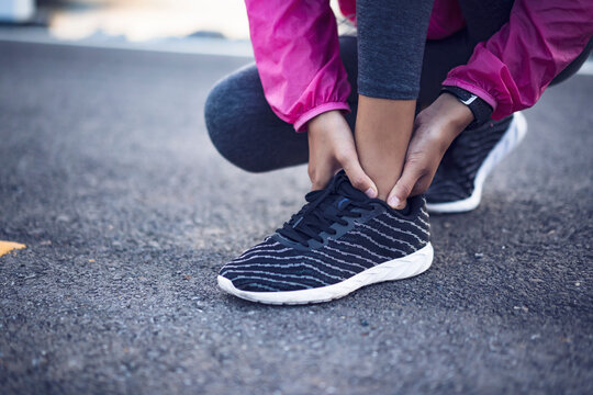 Athlete Asian young girl ankle injury sprain pain hurt running exercise fitness healthy lifestyle resting tired wearing casual jogging clothes, morning sunrise outdoor nature mountain lake landscape