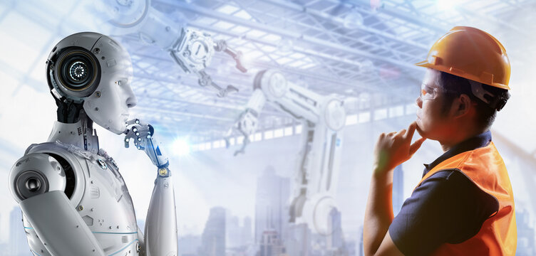 Technician or engineer work with robot in factory