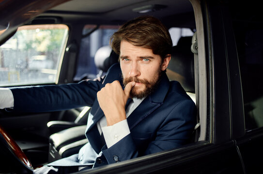 emotional man Driving a car trip luxury lifestyle communication by phone