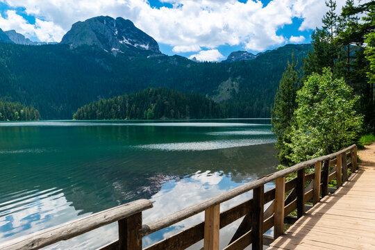 Wooden footbridge over stream. Meded Peak and Glacial Black Lake. Durmitor National Park. Montenegro.