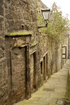 historic close with lamp off Canongate in Edinburgh
