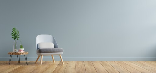 Armchair and wooden table in living room interior,blue wall.