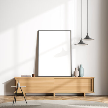 Modern living room sideboard with standing canvas next to white wall