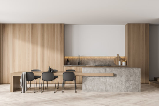Modern light wood kitchen with simplified cabinets and creative table