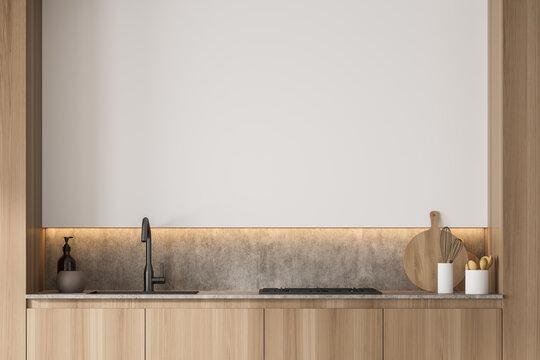 Kitchen niche with marble splashback and white wall detail