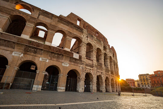 Sunrise at the Colosseum in Rome. Years of history in the eternal city. Roman Empire