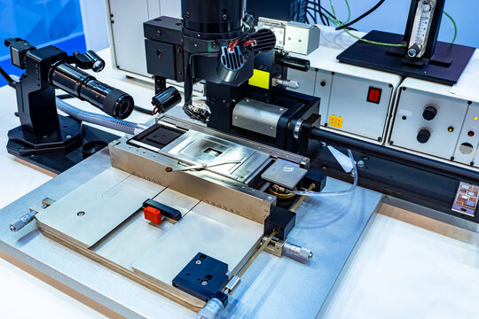Flexible submicron mounting station. Equipment for production of microchips. Close-up of submicron editing station. Device for manufacture of microchips. PCB production machine. Microchip production