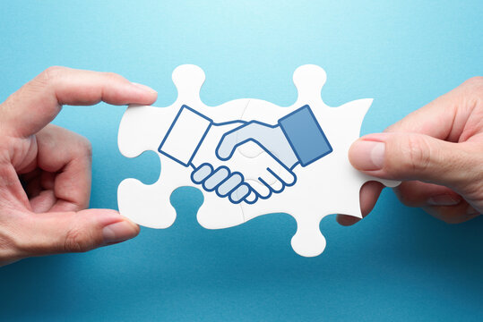 Strategy of business deal. Two hands connecting jigsaw puzzle pieces. Illustration of handshake.