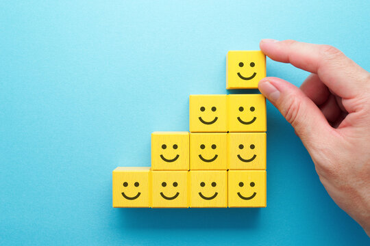 Being happy and lucky. Hand stacking smile wood block.