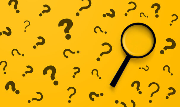 Magnifying glass and question mark sign on yellow background. Searching information data on internet networking concept