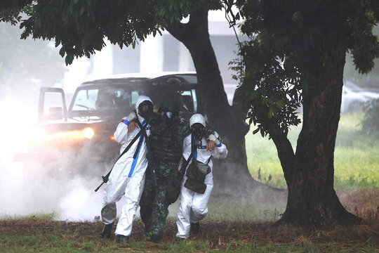 Soldiers take part in a biological and chemical warfare drill during the annual Han Kuang military drill in Tainan