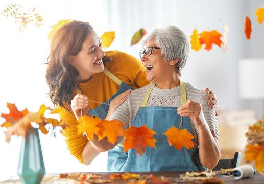 Women doing autumn decor