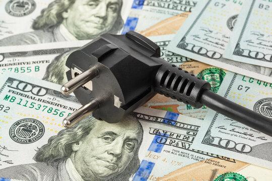 Electric plug on money