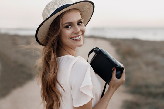 happy young woman with camera outdoor