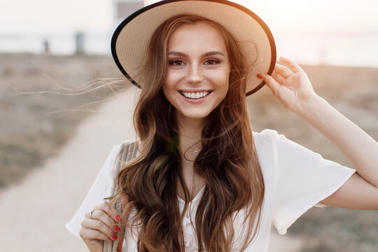 Young happy smiling woman in hat outdoor