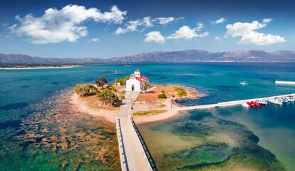 Fototapeta View from flying drone of Saint Spiridon church in Elafonisos port. Incredible morning seascape of Mediterranean Sea. Spectacular outdoor scene of Elafonisos island, Greece, Europe. obraz