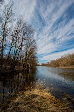 River and deciduous trees.