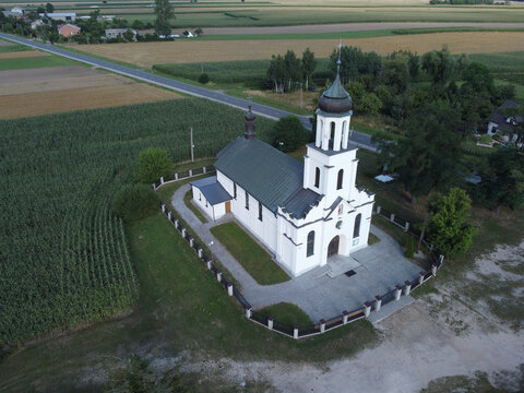 Church seen from above in the village of Brzykow, Poland.