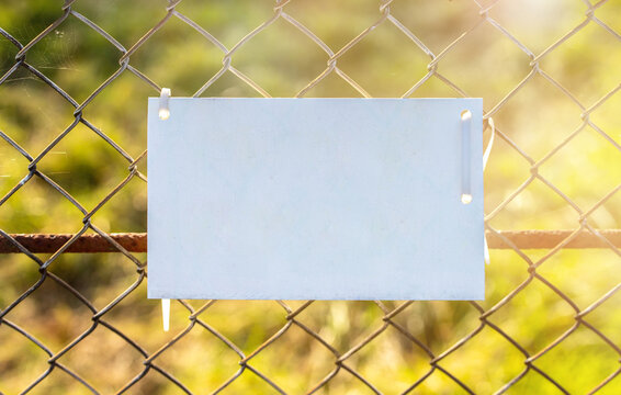 sign on fence under sun light