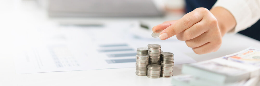 Growing savings concept. Saving money by hand putting coins money banknotes financial accounting planning.