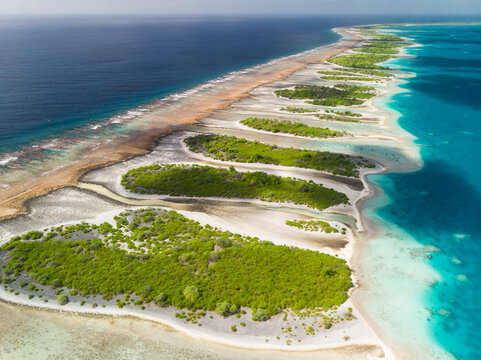 Small islands and channels (Motus and Hoas) separate reef from lagoon on Orona Atoll in Kiribati