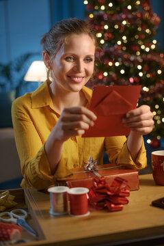 Woman reading a Christmas card