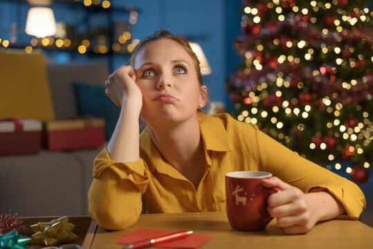Pensive woman staying at home on Christmas day