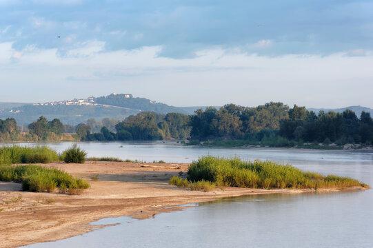 Sandbank in the Loire river and hill of Sancerre village