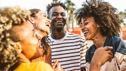 Young happy people laughing together - Multiracial friends group having fun on city street -...