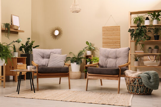 Lounge area interior with comfortable armchairs and beautiful houseplants