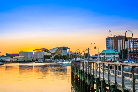 View of Hampton Virginia downtown waterfront district seen at sunset under colorful sky