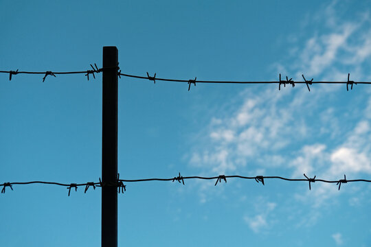 metal barbed wire on sky