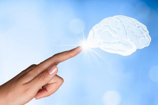 A Businessman hand touching Virtual reality brain.