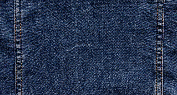 texture of blue jeans denim fabric background