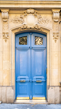 Paris, a blue wooden door, typical building in the center