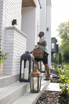 Man with briefcase returning home