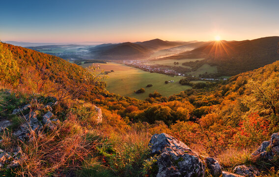 Autumn mountain panorama with golden forest and village in Slovakia