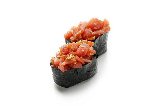 Gunkan sushi with tuna tartare, isolated on white background. 2 piece gunkan-maki set with chopped raw fish, rolled in nori sheet. Packshot photo for sushi restaurant menu, for package design.