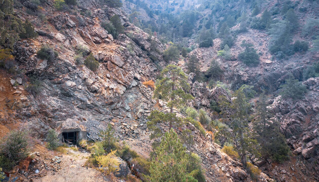 Mountains landscape with an adit of old abandoned mine