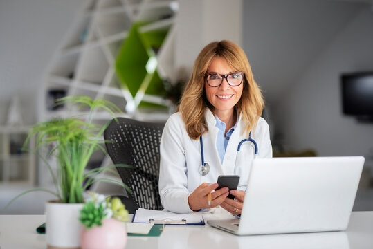 Female doctor using laptop while working at doctor's office