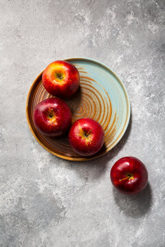 Red apple on plate autumn concept food fruit