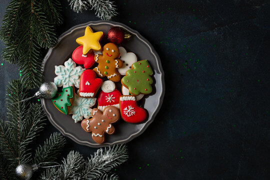 Overhead view of sweet holiday cookies, gingerbread men, Christmas