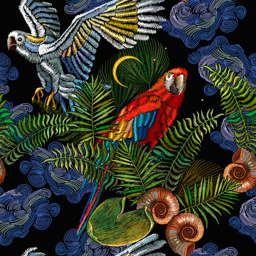 Embroidery. Tropical night. Colorful parrots, palm leaves and moon seamless pattern Fashionable jungle, hot summer background. Template for design of clothes