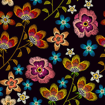 Embroidery flowers. Fashionable template for design of clothes. Beautiful chamomiles, cornflowers, classical seamless background, t-shirt design