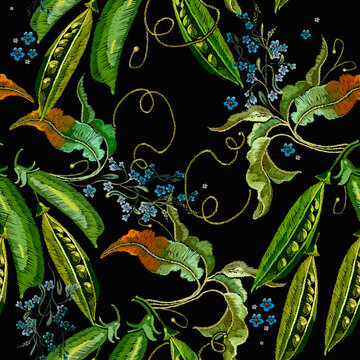 Pods of green peas and blue flowers. Classical embroidery vegetables. Food art. Template for clothes, t-shirt design. Seamless pattern