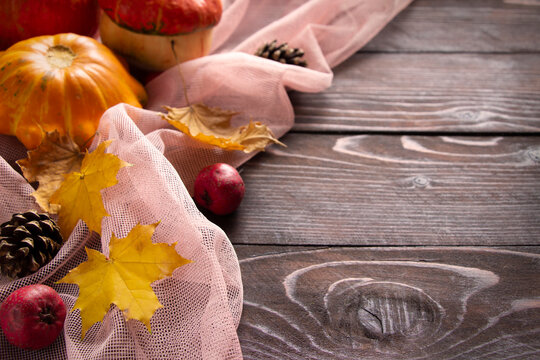 Autumn pumpkins background on wooden brown board.. Thanksgiving and Halloween template
