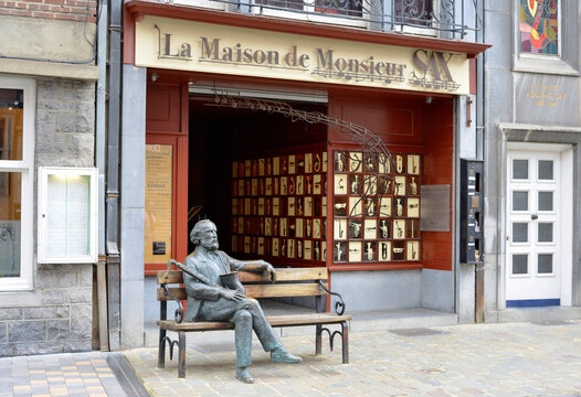 Dinant, Belgium 08-17-2014 Adolphe Sax Museum and sculpture of the inventor of the Saxophone