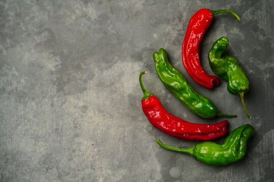 HomegrownShishito and Cayenne peppers background with copy space, top down view