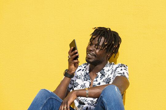 smiling black man recording voice message