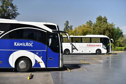 Antalya, Turkey - October 9 2018: Intercity buses of Kamil Koc and Guney Akdeniz Seyahat of Turkish bus companies on central station